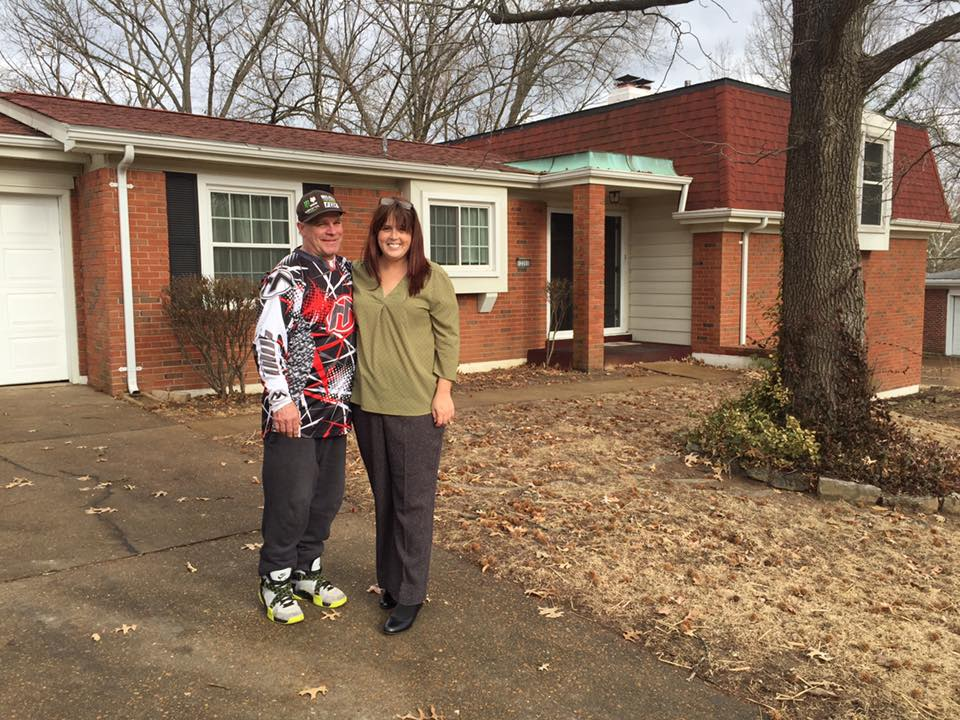 Shane and Jenny Tripp in front of their new Angels' Arms' home.